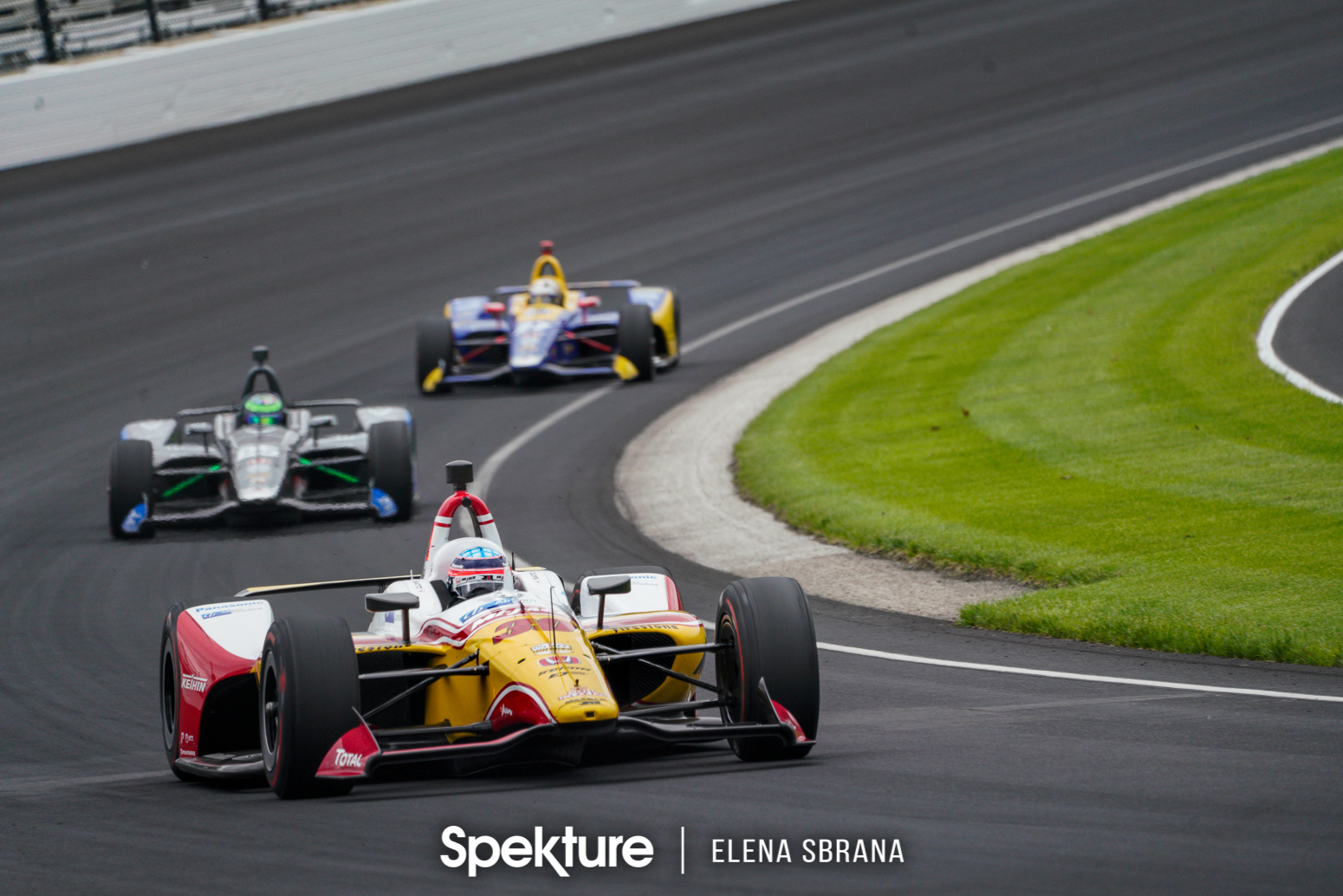 Earchphoto Sports - Takuma Sato leading a group of cars on the IMS oval